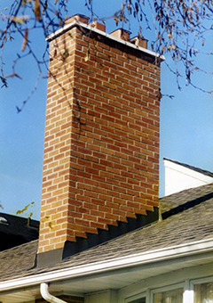 A chimney structure over a house requiring masonry work