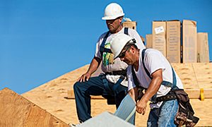 two roofing contractors conducting roof repair