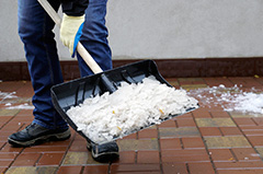 Worker Removing Ice From Sidewalk