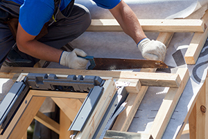 Roofers Retrofitting Skylight