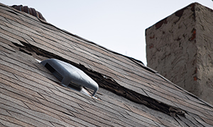 Damaged Roof Shingles After A Storm