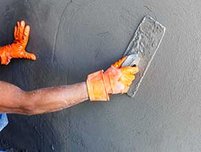 A Workman Working On a Wall